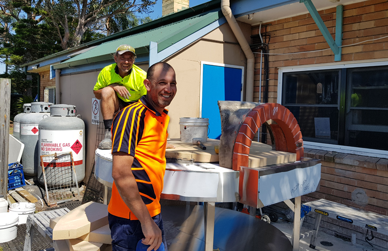 TEA GARDENS HOTEL: Tradesmen building a new outdoor pizza oven.