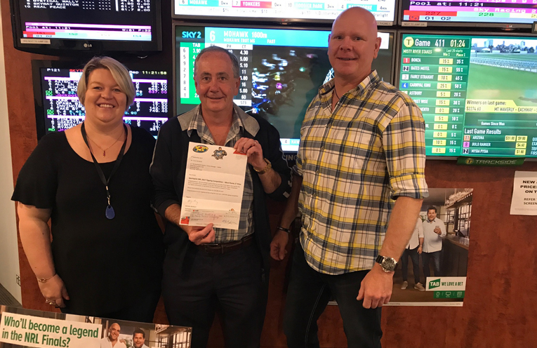 Grant receives the winner's cheque: Debra Robinson (Gaming Supervisor); Grant Bendeich; Peter Trenaman (Licensee). Photo by Marie Loach