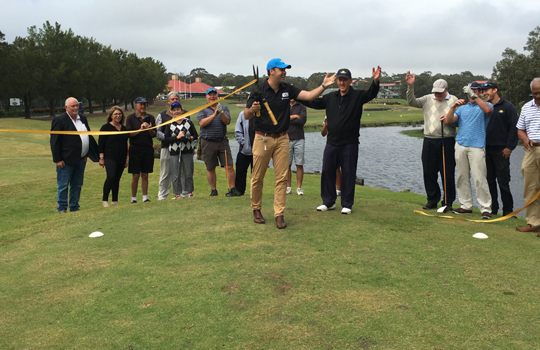 Mayor Ryan Palmer cutting the ribbon as he opens the new ninth hole at Horizons Golf Resort. Photo by Marian Sampson
