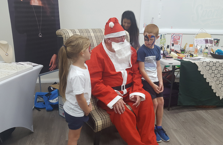 The Jolly man in a red suit gave out lolly bags, backpacks and hats to excited children.