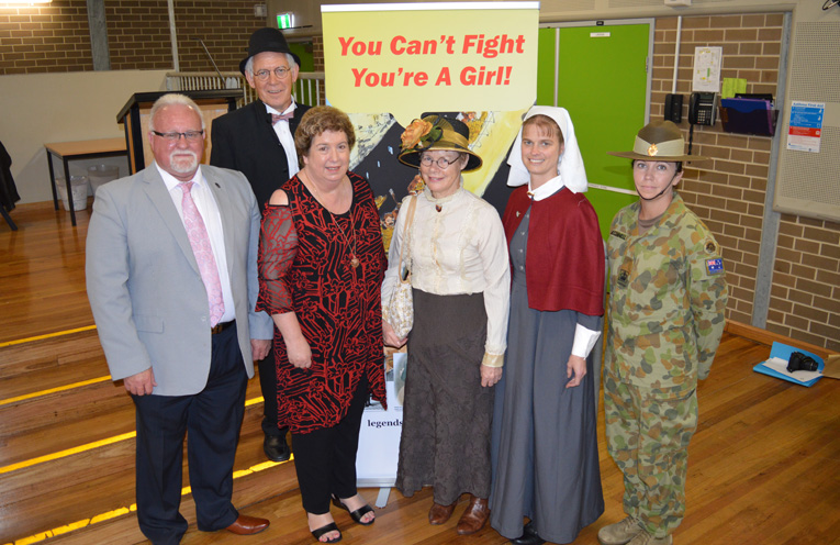 Authors John Gillam and Yvonne Fletcher with organisers of the King Street Festival, Kaye Newton and Peter Robinson alongside Mrs Renae Jenkins dressed as a World War I nurse in authentic replica uniform, and WO2 Kristy McConnell from 8 Combat Service Support Battalion based at Adamstown.