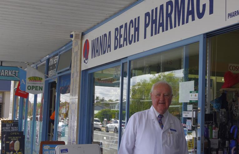 Kerry Schiemer outside Wanda Beach Pharmacy where he still give good advice. Photo by Marian Sampson.