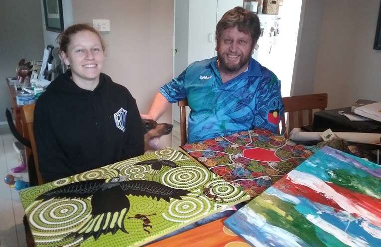 Morgen and Peter Kafer with some of their art pieces.