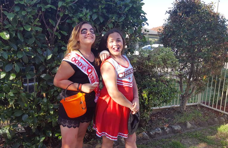 Two school friends having a blast on Halloween.