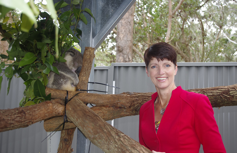 Kate Washington with Tolley at the Port Stephens Koala Sanctuary. Photo by Marian Sampson.