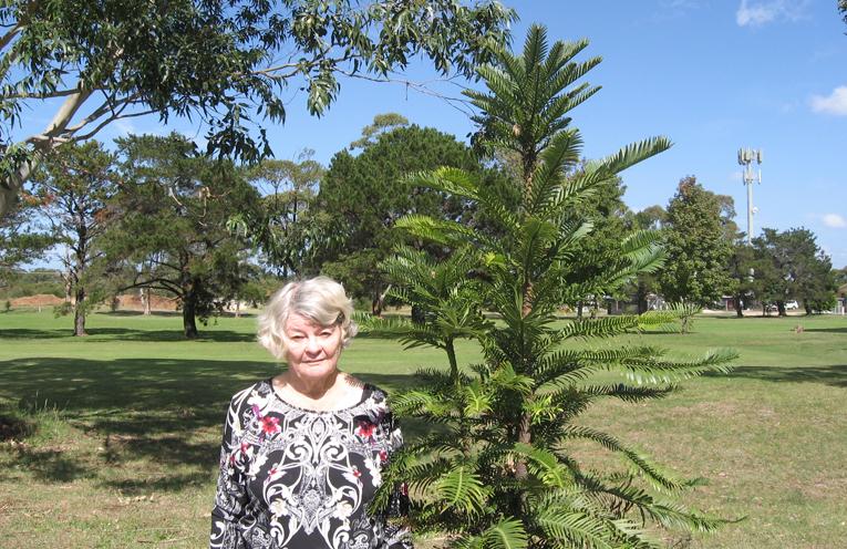 Leone with Doug's memorial pine tree.