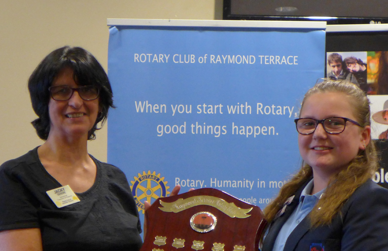 Rotary Club President Jacky Gendre presenting the Shield to Tahlia Jarvie from Seaham Public School.