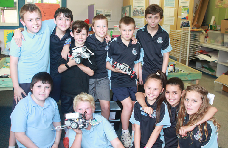 Students pictured with EV3 Lego Robotics. These computers have a larger 'brain' than the computers inside the Apollo Spacecraft which took man to the Moon.