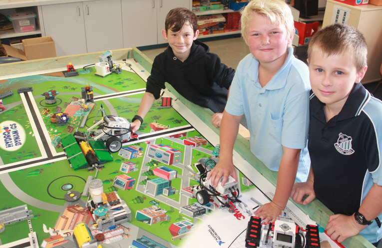 Caleb Whitter, Jackson Cheetham and Oska Greentree with some of the robotics equipment.
