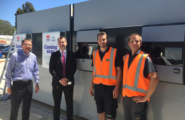 Port Stephens Mayor Ryan Palmer and Parliamentary Secretary for the Hunter Scot MacDonald MLC get shown the workings of the new machine by the installation team.