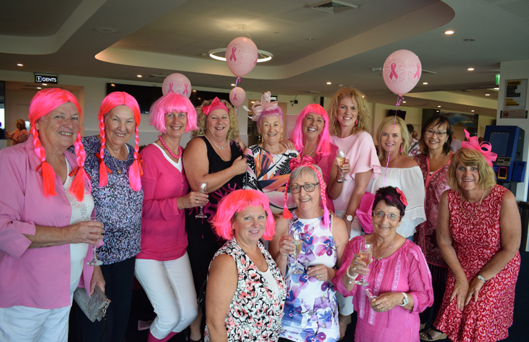 A Group of the ladies who got right into the pink spirit for the fundraiser.