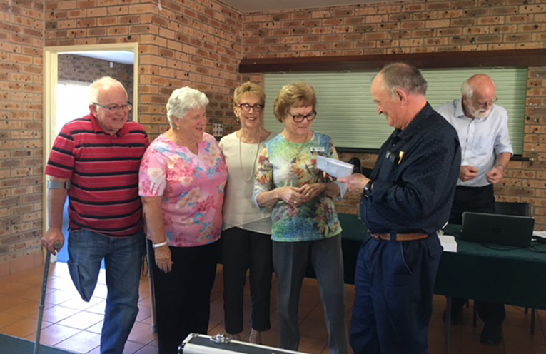 The winning Tomaree Bridge Club Team (Sunday Teams Event) Jim Thatcher, Evon Williams, Margaret Sylow and Carolyn Seymour with Tomaree Bridge Club president Kevin Farrell is presenting their prize.