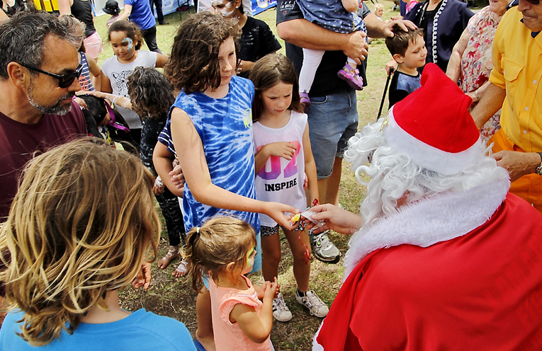 Santa brought lollies for all the children visiting the Festival.