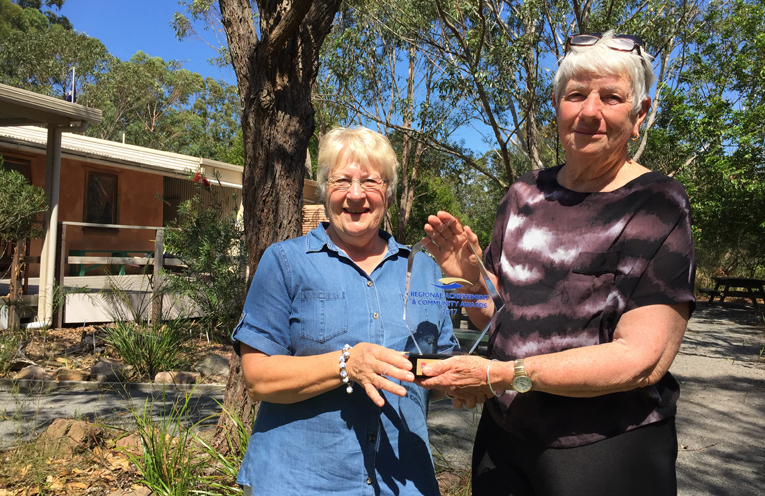 President Dorothea Willey and past president and long term volunteer Fran Corner with their treasured new award.