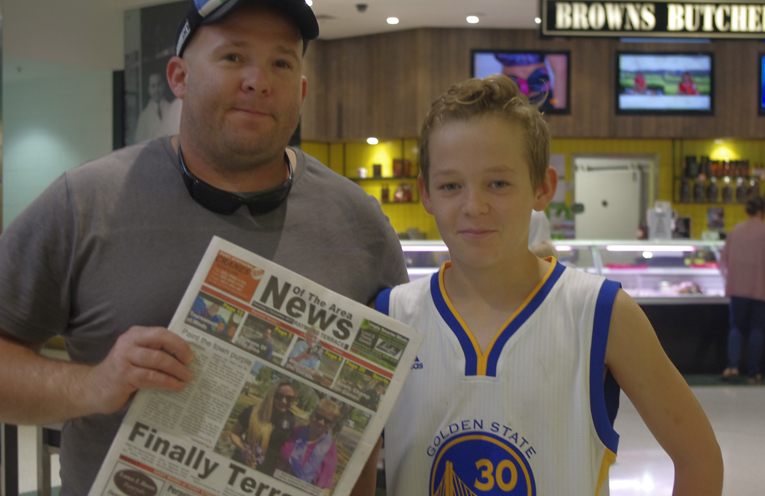 Tom and Millar Morton with the first copy of Raymond Terrace's News Of The Area to be handed out. Photo by Marian Sampson.