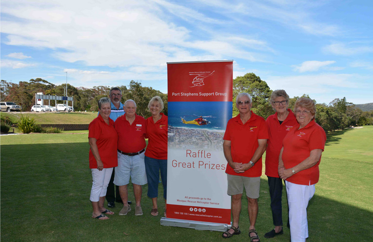 Volunteers and Manager of Nelson Bay Golf Club, preparing for the upcoming event. Photo by, Mandy Ellis.