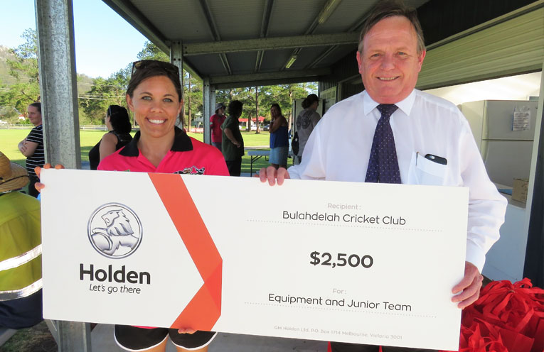 Junior cricket team manager Erin Matheson with Newcastle Holden Sales Manager Alan Curtis.