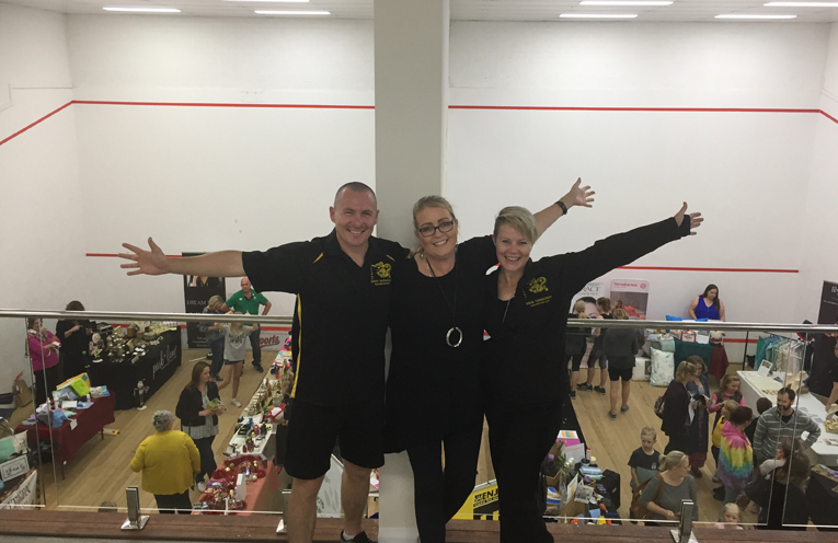 Tony Gillespie, Ali Binskin and Kelly O'Brien on the viewing deck above just some of the stalls within the squash courts.