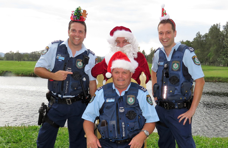 Merry Christmas: Sn Constables Ash Ray, Trevor McLeod and Dave Feeney enjoy a visit from Santa.