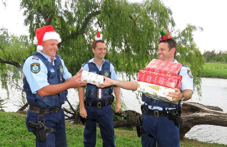 Sn Constables Trevor McLeod, Dave Feeney and Ash Ray share the joy of Christmas.