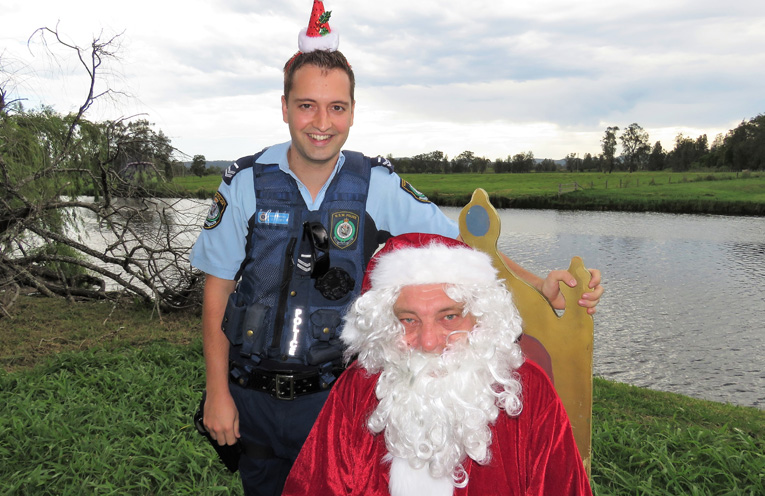 Sn Constable Dave Feeney enjoys a visit from Santa.