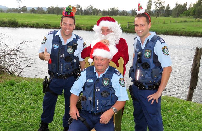 Sn Constables Ash Ray, Trevor McLeod and Dave Feeney with Santa.