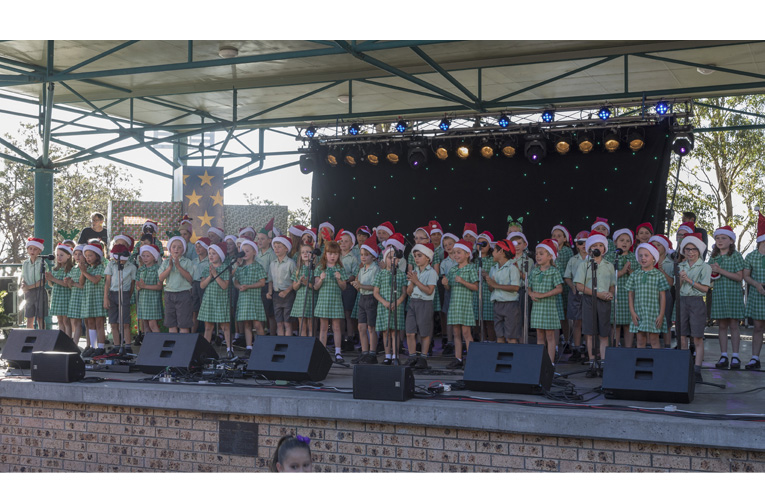 School Students stealing the show at the Fly Point Carols. Photo by Henk Tobbe.
