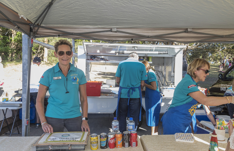Rotarians sausage sizzle with Rotarian and Tomaree BusinesS Chamber President Leah Anderson. Photo By Henk Tobbe.