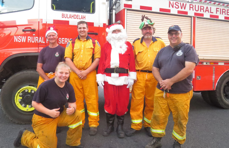 Grahame Rowell, Meagan Terry, Jake Blanch, Santa, Scott Bidwell and Brigade Captain Mark Hartwell.