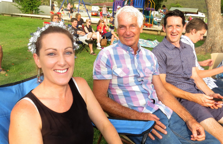 Meg, Russell and Jordan Guthrie enjoy the carols.