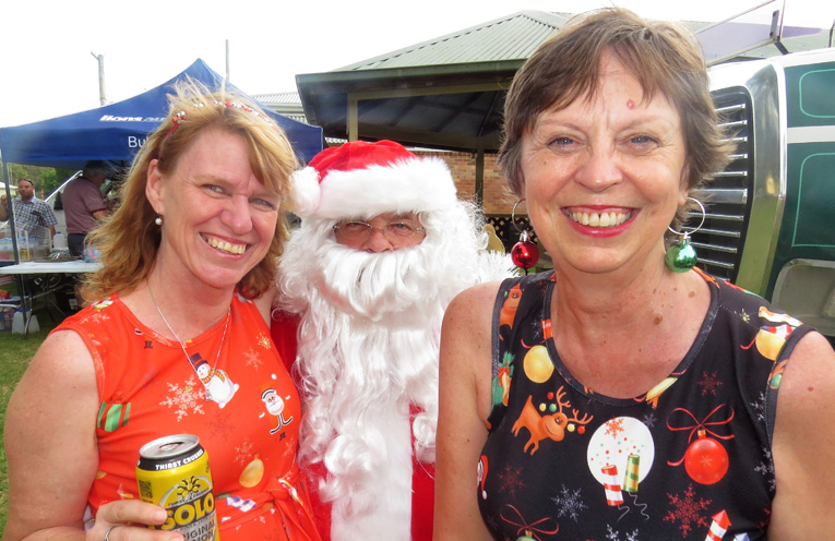 Kathy Aquilina and Leanne Barrett with Santa.