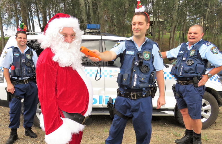 Senior Constables Ash Ray, Dave Feeney and Trevor McLeod ensure Santa is fit to drive his sleigh.