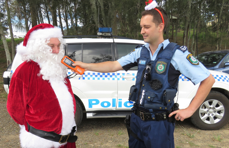 Senior Constable Dave Feeney makes sure Santa is fit to drive his sleigh.