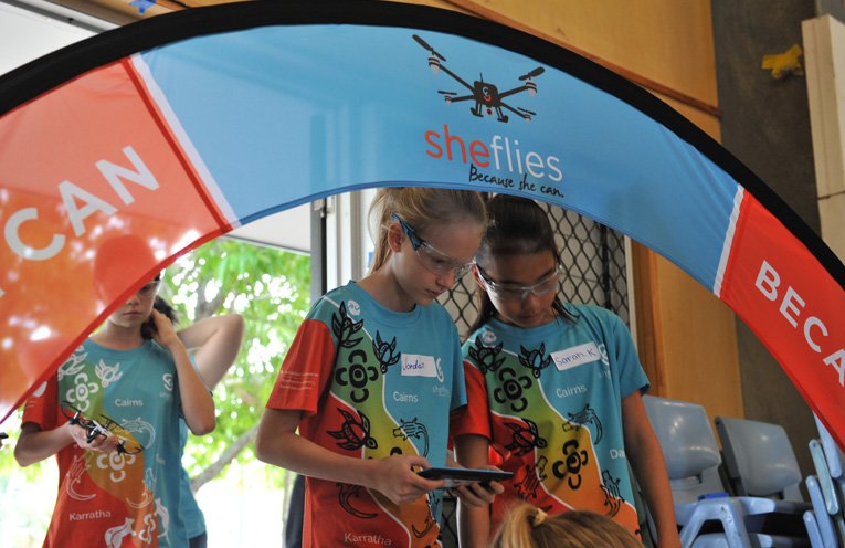 Girls get hands on experience flying drones.
