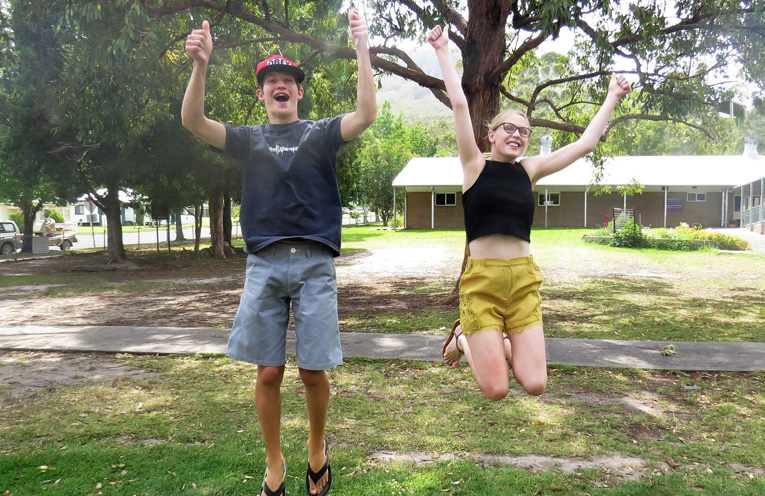 Top Marks: Darcy Harris and Kaitlyn Gregory jump for joy.