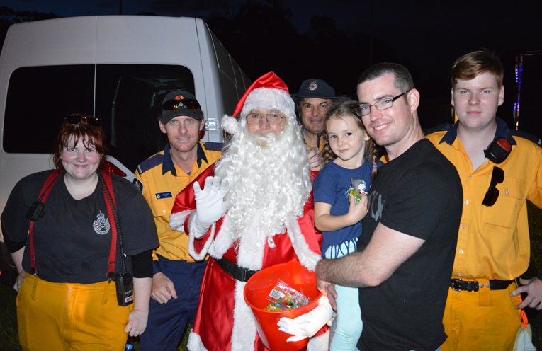 Emmeline Murchie from Grahamstown Public School meets Santa and his helpers.