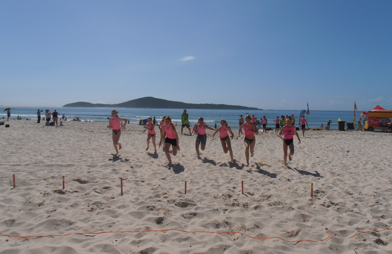 Fingal Beach of a Sunday morning where Port Stephens Nippers are out learning safe water skills. Photo by Marian Sampson.