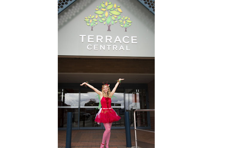Bec 'Elf' Kozis out front of Terrace Central, which is set for a makeover, starting with a Christmas Extravaganza.