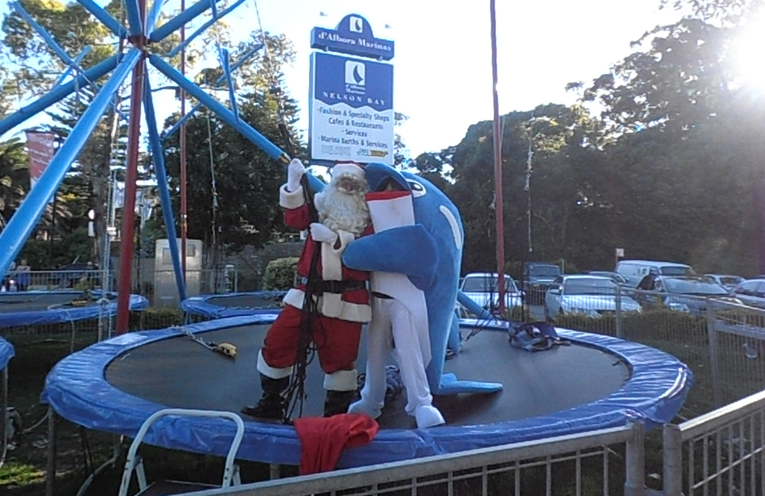 Santa and Splash Nelson Bay's Town Mascot enjoying the Aero Trampolining at Nelson Bay. Photo by Marian Sampson.