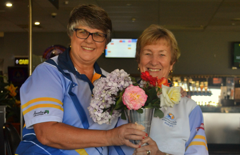 """Club Secretary Karen McPhie and Club President Robyn Webster holding """"The Trophy""""."""