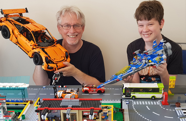 Kevin Evans and and his son Tristan Evans with some of their Lego creations.