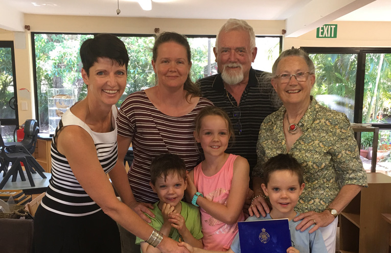 Kate Washington MP presenting Luke with his winning certificate, joined by Luke's mum Madeleine, grandparents Jacqui and Derek, and siblings Caleb and Stephanie.