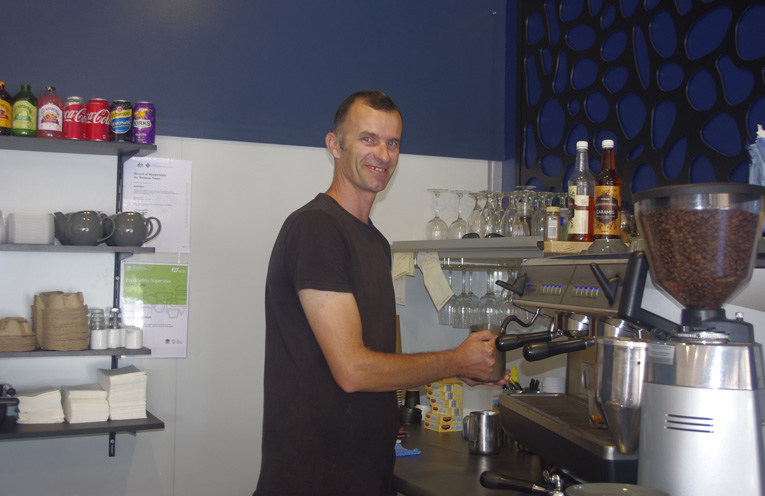 Jeremy Scheerlinck pumping out coffees at Rubi Blue Anna Bay's first new business in the retail trading precinct in years. Photo by Marian Sampson.