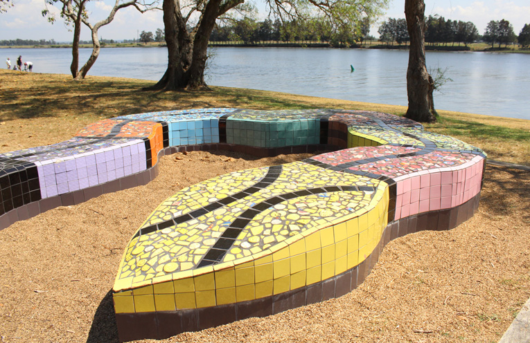 Say hello to the serpent sculpture and enjoy the nearby play equipment down on the river at Riverside Park.