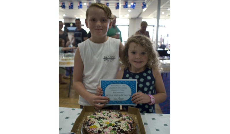 Jack and Ash McDonald were excited to take out 1st place in one category for their Pizza cake!