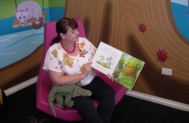 Melissa Donn reading to children.