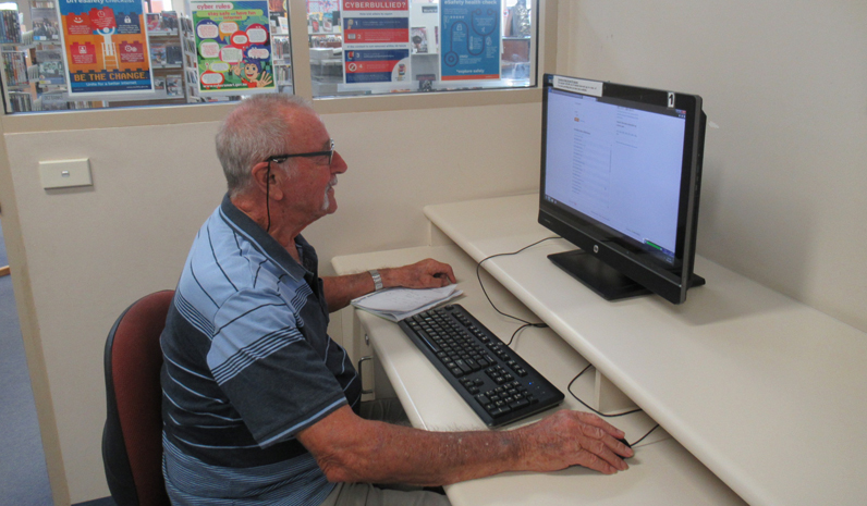 Port Stephens library customer Mr Barry Haigh using one of Tomaree Library's free Internet computers.