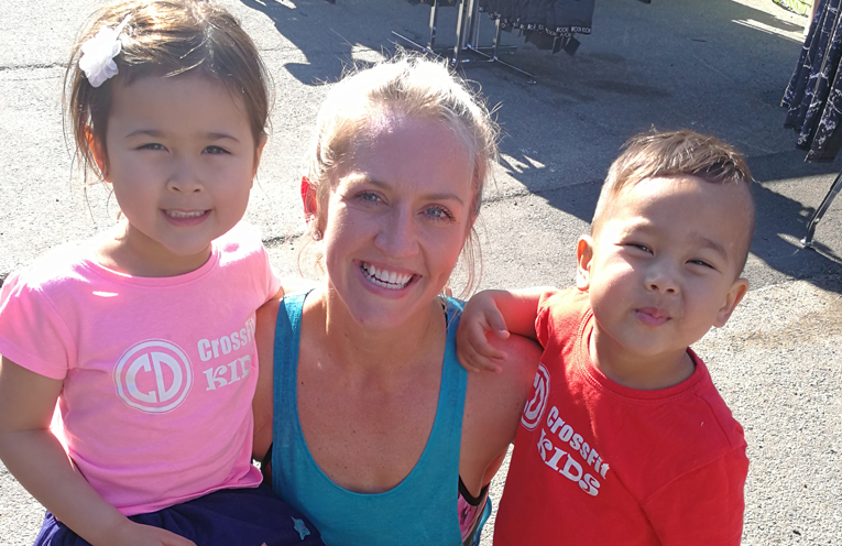 Crossfit Kids Abigail and Fletcher Benseman with Crossfit Coach Kimberly Cox.