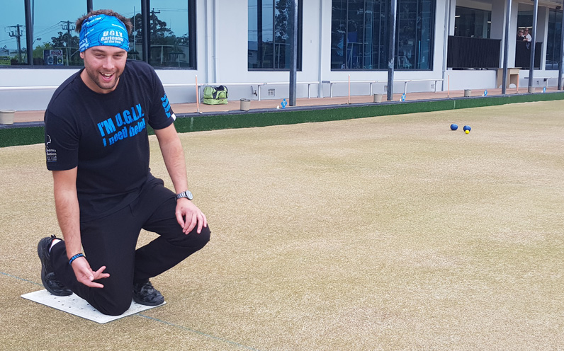 Michael Sercombe, Nelson Bay Bowling Clubs Operations Manager getting into barefoot bowls.