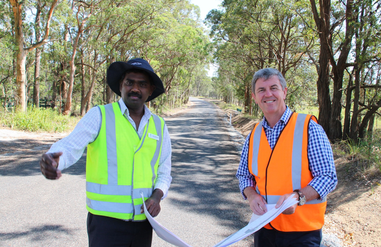 Mid Coast Council's Senior Asset Engineer Gamini Weththasinghe inspects the works with Federal Member for Lyne Dr David Gillespie.